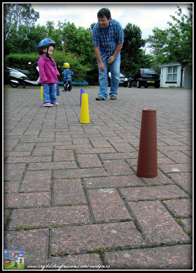 road safety and children, learning to ride a bike, cone dodging, physical activity for boys and girls, outdoor fun, photo