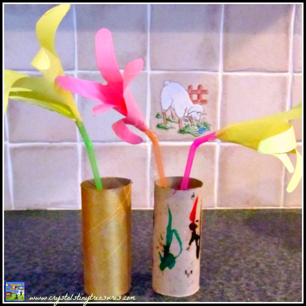 handprint flowers with a cardboard tube vase, toilet paper roll crafts, cardboard roll crafts, photo
