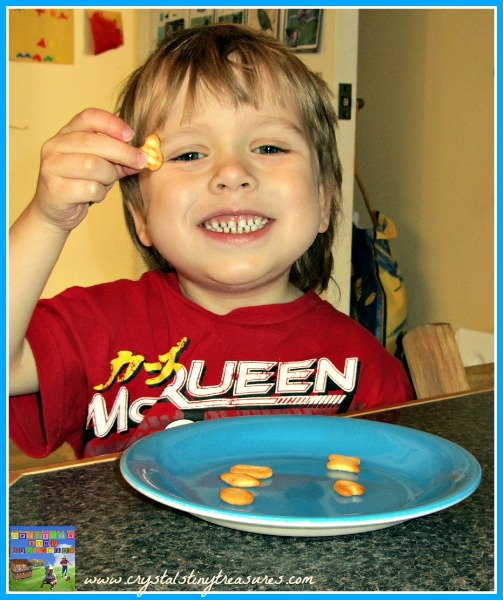 Snack time learning fun with shaped crackers, photo