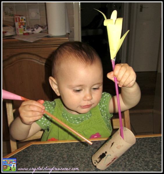 Placing the flower stems into the vase is good for hand-eye coordintation, photo