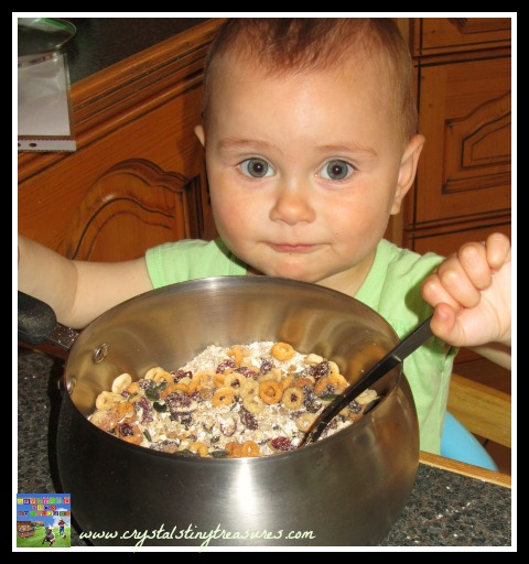 toddlers in the kitchen, mixing the ingredients, kitchen fun with kids, photo