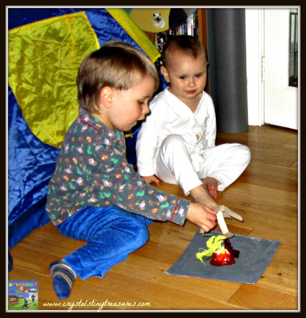 building a campfire with children, indoor fires, rainy day fun, camping crafts, photo