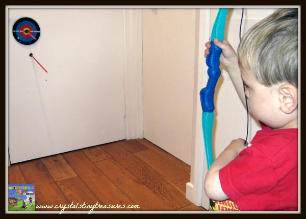 indoor archery and children, sports fun with kids, rainy day sports, hand-eye coordination, photo