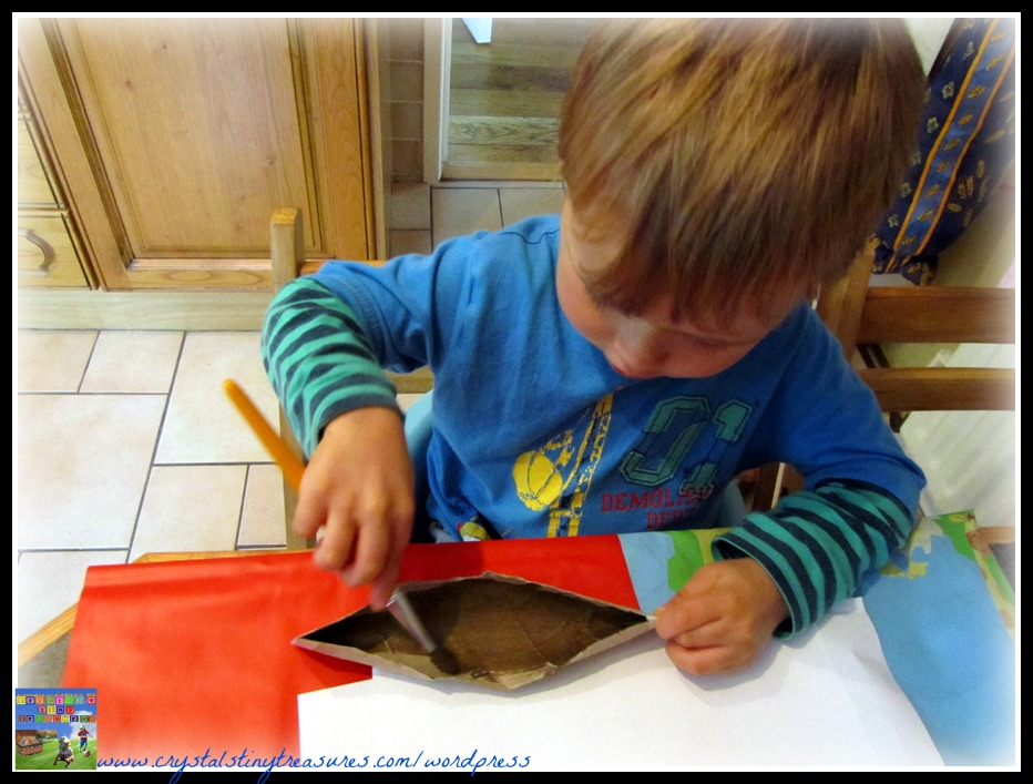 brown paint mixing, canoe painting and kids, rainy day fun with preschoolers, photo