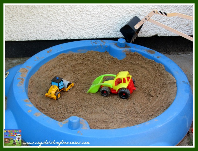 Burried dinosaurs, hunting for fossils in the sandbox, summer fun for kids, photo
