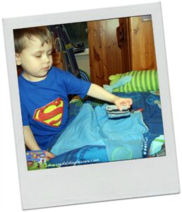 children learning independence, folding the laundry, kids helping with household chores, photo