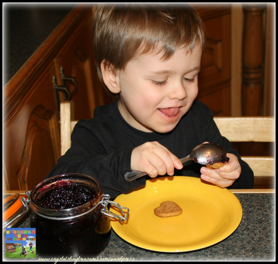 Spreading jam between the cookie layers, kids in the kitchen, sandwich cookies, photo