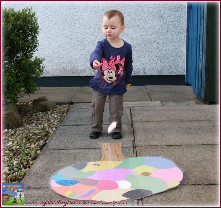 Bean bag toss game, gross motor skills fun for kids, learning colours, springtime fun, photo