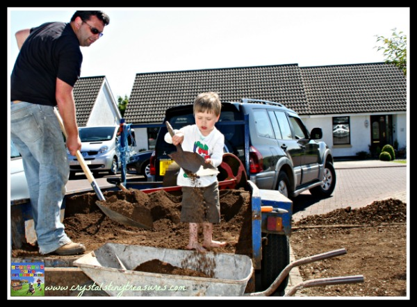 planting a lawn, learning about topsoil, kids and gardening, photo