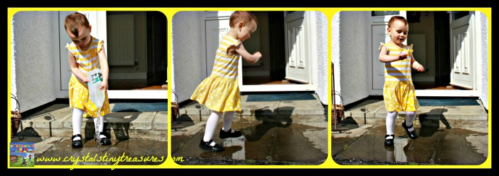 Backyard fun in the summer, splashing in the puddles, summer fun for toddlers, photo