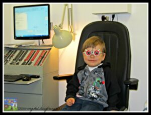 Sitting in the optometrist's chair for the first eye exam, a child's first eye exam, Crystal's Tiny Treasures,