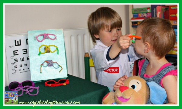 Trying a pair of glasses on for fit, pipe cleaner glasses, photo