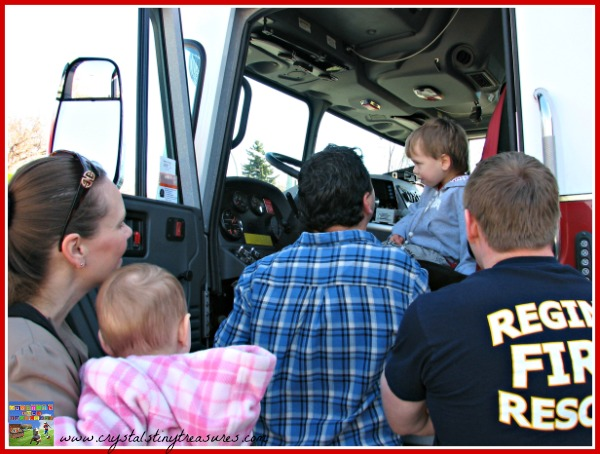 Sitting in the Driver's Seat of a Fire engine, Community Heros, photo