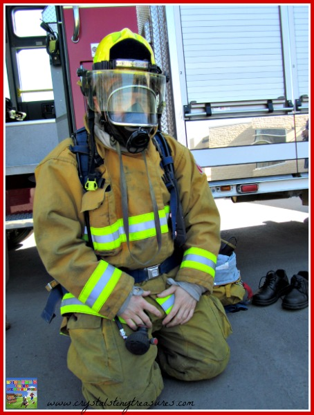 Fireman dressed in protective gear, REgina Fire Department, photo