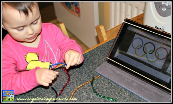Twisting pipe cleaners into Olympic rings, childmindr fun for the Olympics, homeschooling Olympic activities, photo