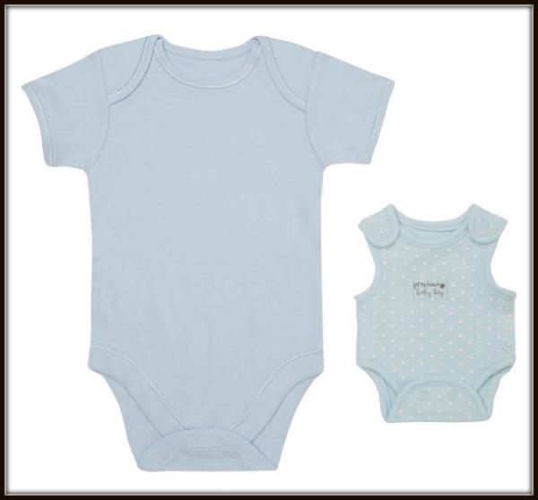 George premature baby clothing alongside newborn size, photo