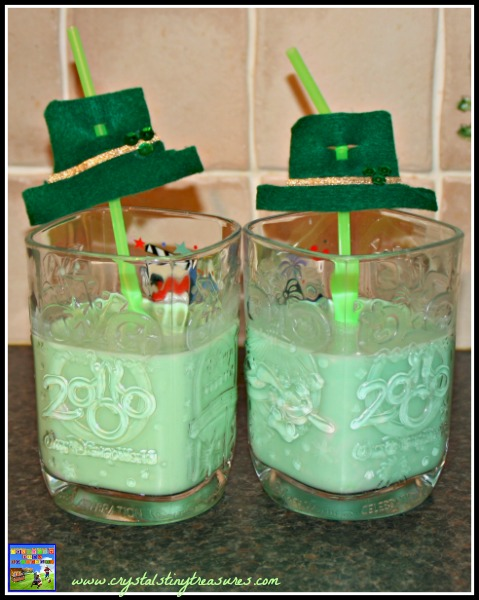Enjoying shamrock shakes with Leprechaun hat straws, St. Patrick's Day decorations, photo