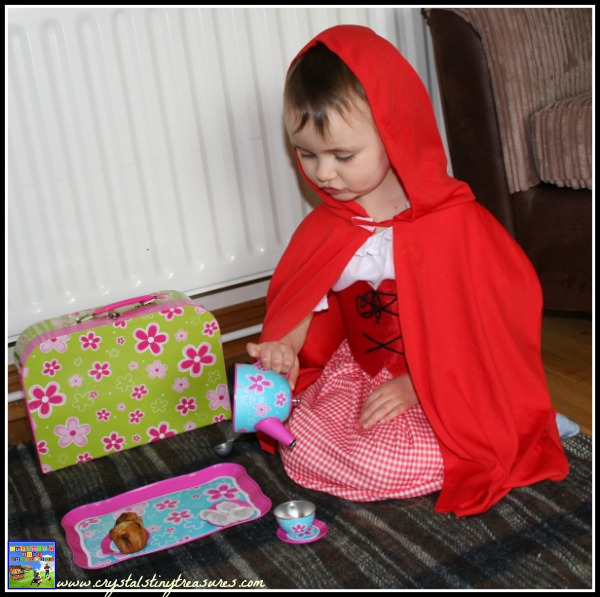 Pouring a cup of pretend tea, Crystal's Tiny Treasures, make-believe kids play, photo