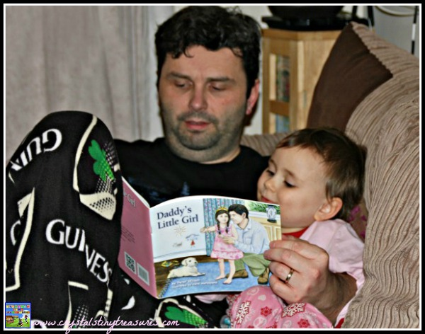Father reading a story book to his daughter, Crystal's Tiny Treasures, bedtime books for kids, photo