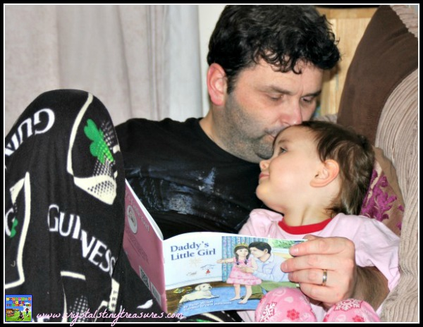 Father and daughter sharing a special moment, great books for Father's Day, family favourite books for children, photo