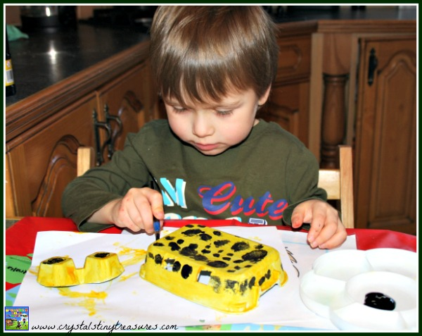 Painting a poison dart frog craft, learning about the Amazon, Rainforest crafts for kids, photo