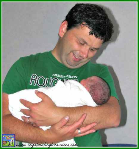 Daddy's first time holding his baby girl, photo