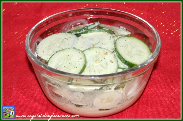 Creamy cucumber and onion salad, summer side dish, kids in the kitchen, photo