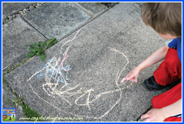 Draw a picture with sidewalk chalk, outdoor summer fun, photo