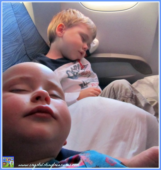 kids sleeping on a long-haul flight, flying with kids