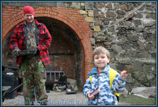 Holding a piece of 400-year-old roof tile at Carrickfergus Castle Excavation