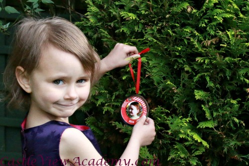 Hanging a personalised tree ornament to cherish from I See Me!