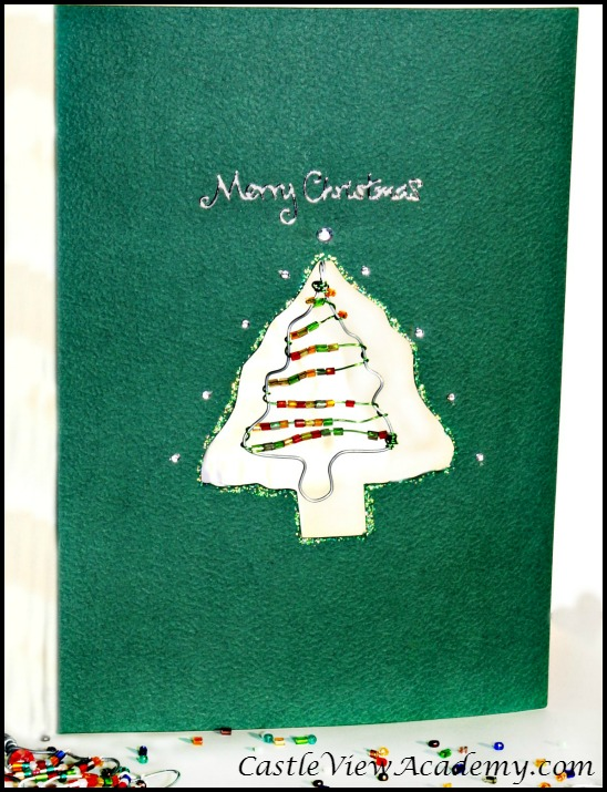 A pretty Christmas tree ornament turned into a card that will bring cheer every year.