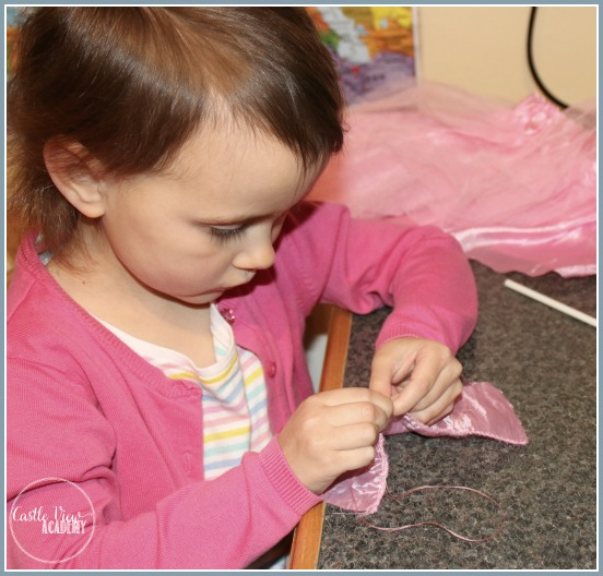Practicing sewing skills while making a clothespeg ballerina doll