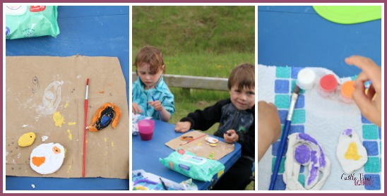 Painting Egyptian amulets while camping with Castle View Academy