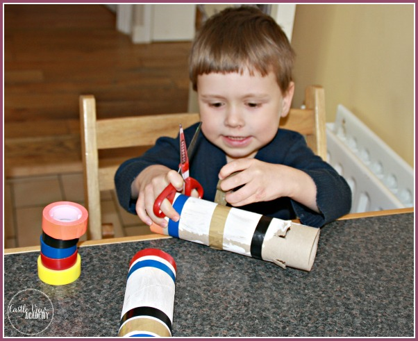 Using electrical tape for kids crafts at Castle View Academy to make a cardboard tube lighthouse