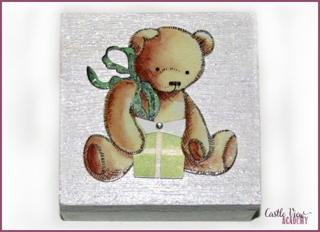 A pretty painted and embellished wooden box for charity at Castle View Academy homeschool
