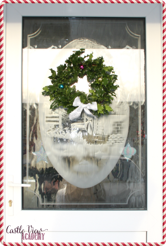 Easy DIY Foraged Christams Wreath looks great hanging on a door with Castle View Academy