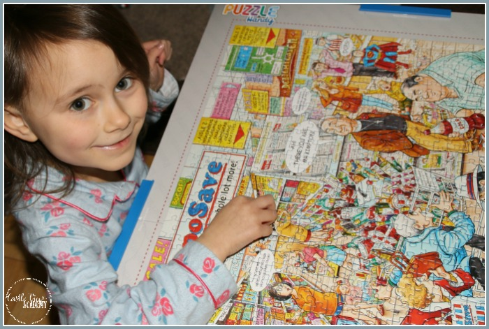 Adding the last piece to the Best of British Supermarket jigsaw puzzle at Castle View Academy homeschool