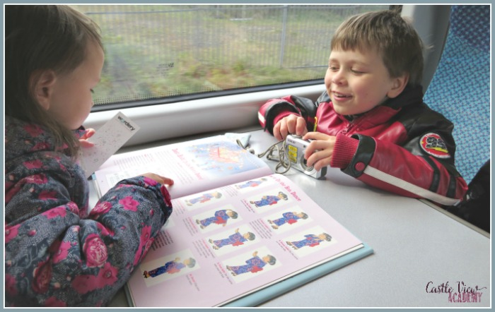 Reading All About Japan on the train with Castle View Academy homeschool