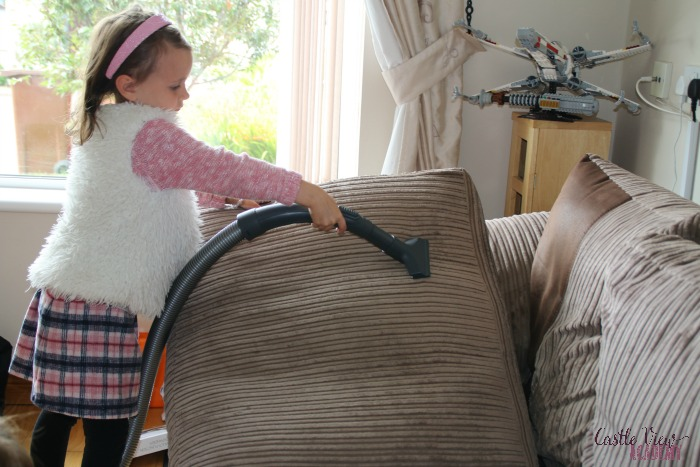 Learning to vacuum at Castle View Academy homeschool