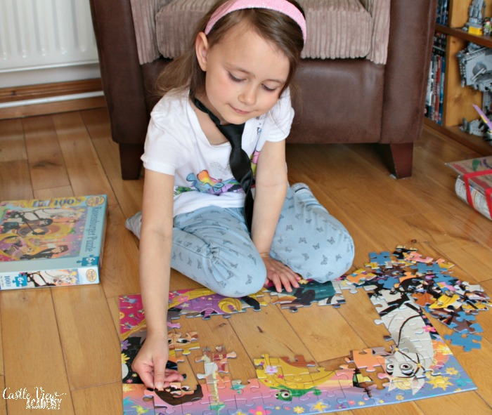 Ravensburger's Tangled puzzle is going well at Castle View Academy homeschool