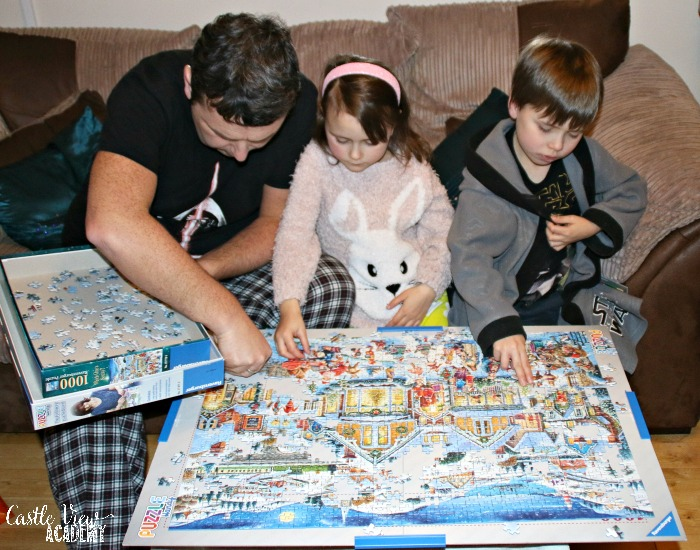 Castle View Academy has some together time putting to gether a Ravensburger Christmas puzzle