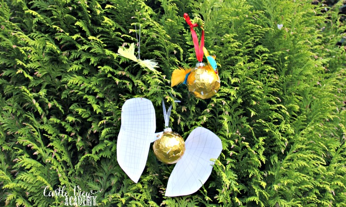 Kid-made Harry Potter Golden Snitch craft tree ornaments at Castle View Academy homeschool
