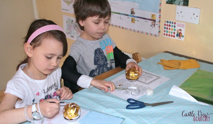 Making a Golden Snitch craft at Castle View Academy homeschool