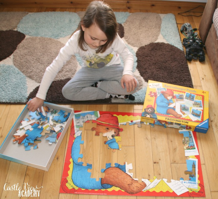 Castle View Academy works on a Paddington Bear floor puzzle