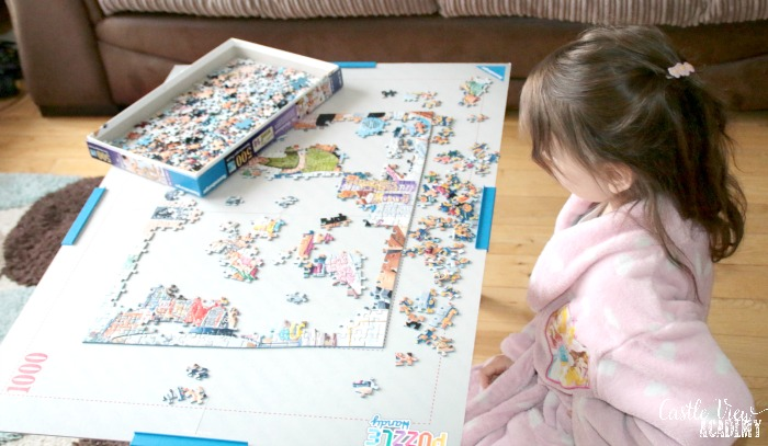 Castle View Academy homeschool gets up early to work on a puzzle