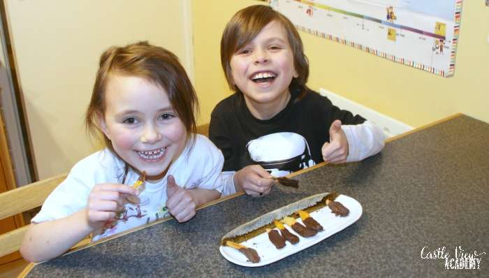 Having fun with chocolate covered mango slices at Castle View Academy homeschool