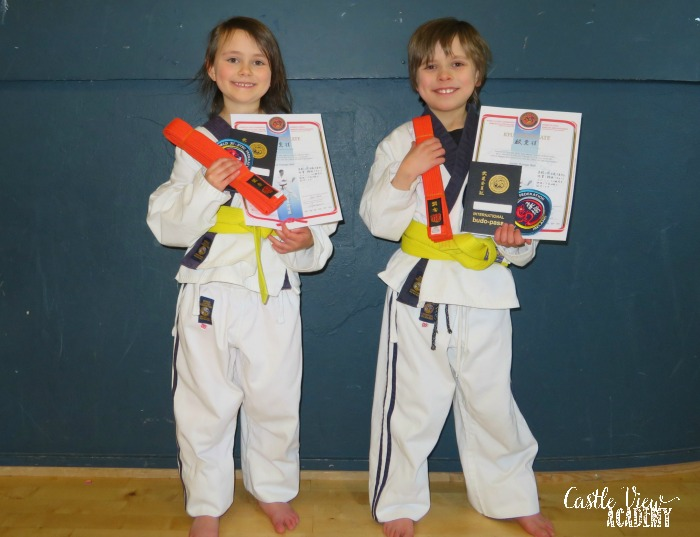 The kids of Castle View Academy have their orange belts in Ju-Jitsu