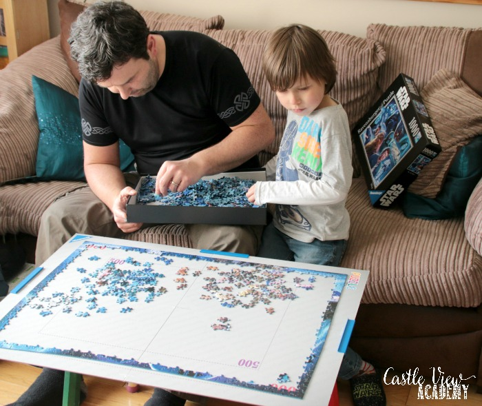 Castle View Academy homeschool works on a Ravensburger Star Wars puzzle