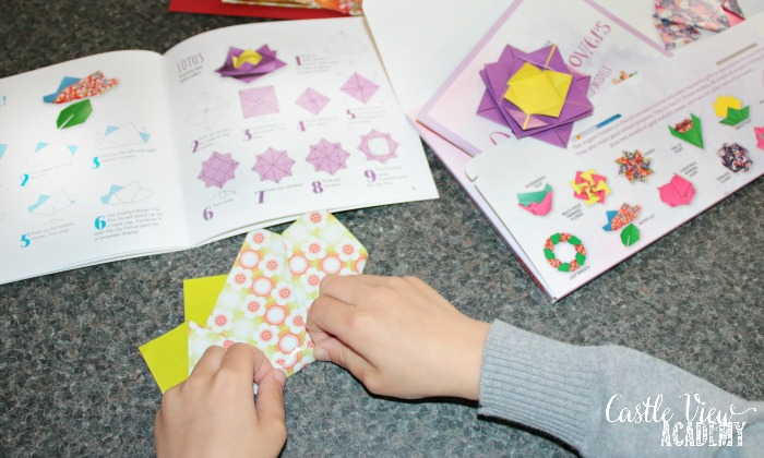 Castle View Academy homeschool folds Origami Flowers from Tuttle Publishing